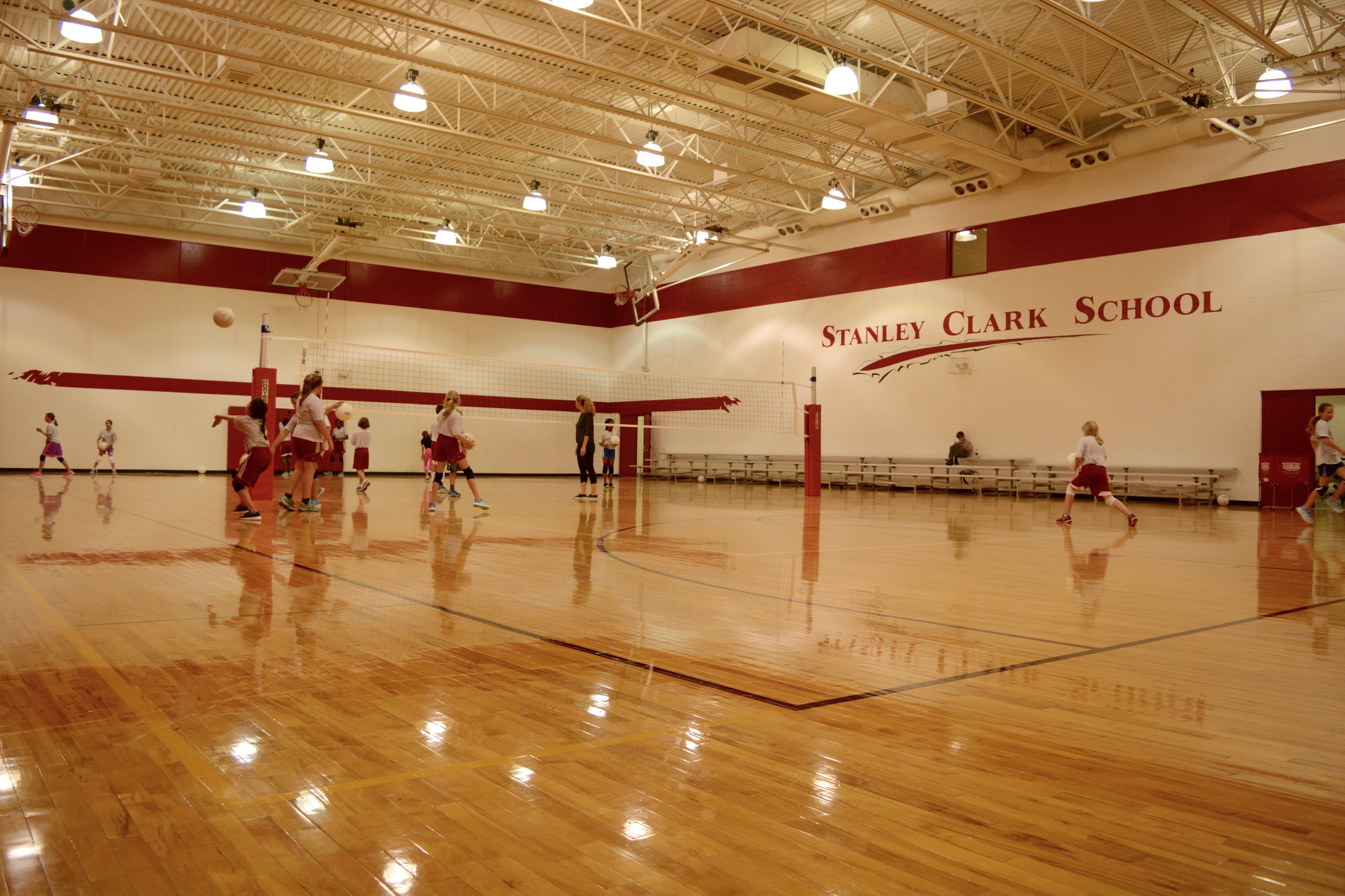 Large Gym with students playing volleyball
